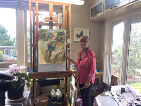 Painter Cathy Goodale at her easel in her Estes Park home. Not a bad place to Stay-at-Home. In addition to her own work, she's been getting creative about how to teach her painting class in a virtual world.