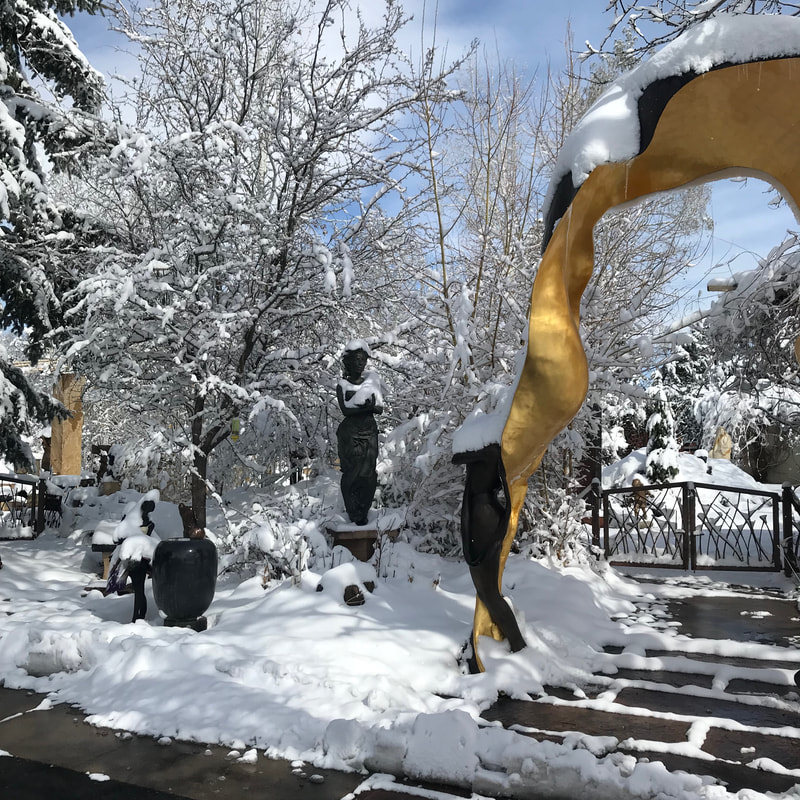 April Showers??! Sometimes the showers involve snow.  What a difference a day makes! The National Sculptors' Guild Sculpture Garden is looking really different today from what it did on Tuesday.  We can't wait to see how this big wet snow helps the flowers coming up... the forsythia didn't fair well.  #SpringInColorado #PoorForsythia #AprilBlizzard