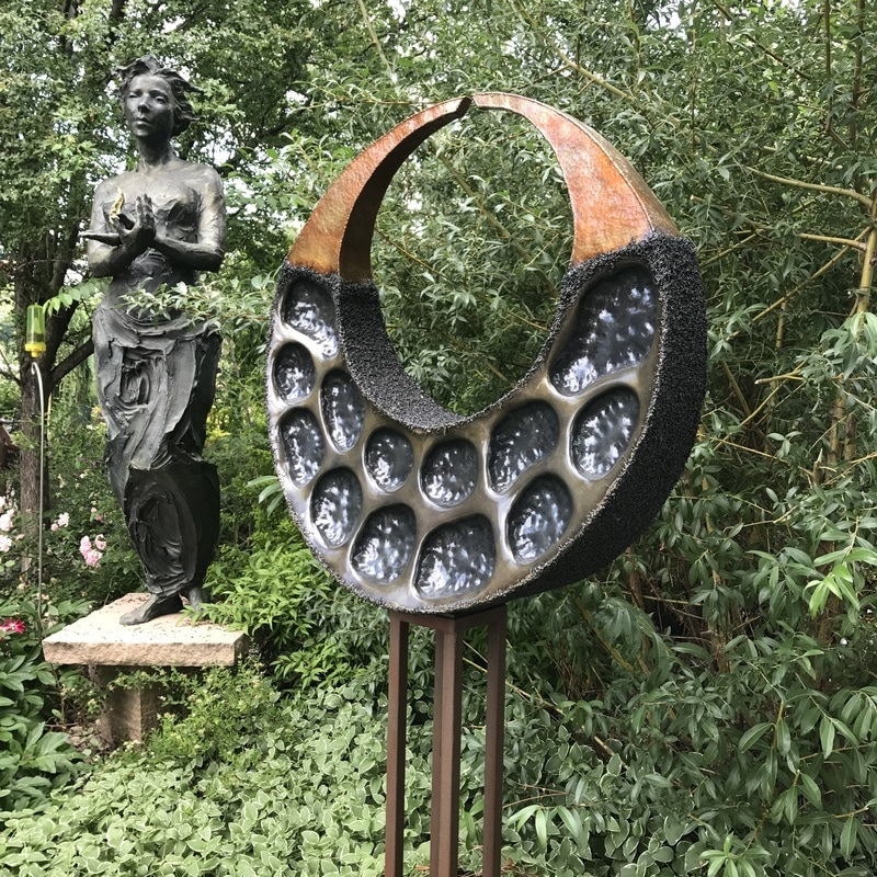 Stephen Shachtman's Lunar Acorn shown with Jane DeDecker's Fire. The National Sculptors' Guild Sculpture Garden is filling up for summer with new sculpture and blossoms. We are pleased to have three new pieces from Stephen Shachtman. click the images below to shop online.