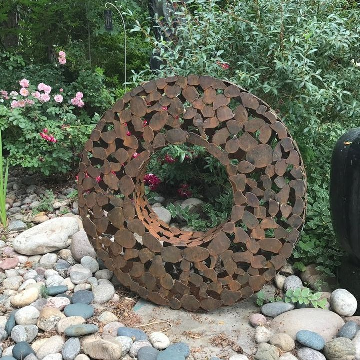 Steve Shachtman's Lunar 4. The National Sculptors' Guild Sculpture Garden is filling up for summer with new sculpture and blossoms. We are pleased to have three new pieces from Stephen Shachtman. click the images below to shop online.